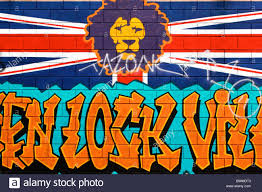 a mural of a lion on a union jack flag with graffiti letters below a mural of a lion on a union jack flag with graffiti letters below