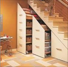 gorgeous under stair storage look charleston transitional