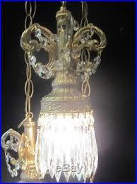 hollywood regency swag l regency vintage hanging swag l chandelier spelter brass metal cryst