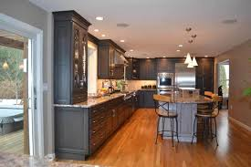 espresso kitchen cabinets with white countertops why homeowners fall in with espresso cabinets