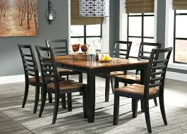 extension dining room table ashley furniture quinley two tone extension dining table side