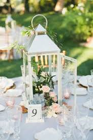lantern centerpieces for weddings lanterns work great as centerpieces because you do not need a lot