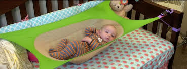 crescent womb a newborn crib hammock which helps reduce risk of sids