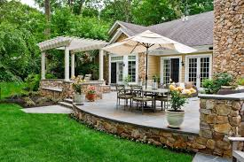 Stone Decks And Patios by Spanish Influenced Raised Stone Patio Beechwood Landscape