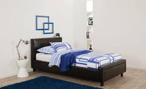 Chocolate Bed Linen - lara upholstered kids bed with blue and white patterned linen and