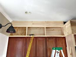Kitchen Cabinet Top Molding by Building Cabinets Up To The Ceiling From Thrifty Decor