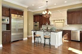 green kitchen cabinets with white island 43 kitchens with extensive wood throughout home