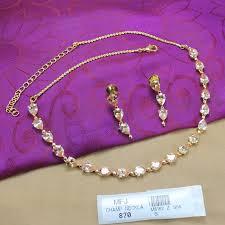 Buy Designer Gold Plated Golden Golden Yellow Colour Stones Thilakam Design Gold Plated Finish