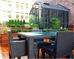 terrace garden design striped canopy above dining table set in