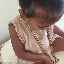 girl wear necklace images Kim kardashian posts photo of north west wearing kanye 39 s chain jpg