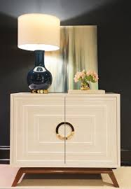 classic foyer features concentric cabinet with navy lamp designed