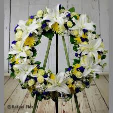memorial wreath tribute of white lilies yellow fuji mums and roses