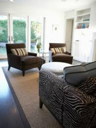design balance and room decorating in this living room the bold sofa is balanced by the windows and the two dark chairs with patterned pillows the softly textured rug creates a conversation