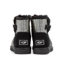 ugg womens mini bailey button sale lyst ugg mini bailey button bling shearling lined boots in black