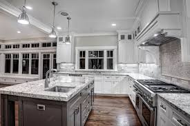 grey kitchen backsplash and white cabinets floor with off yellow