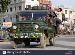 jeep india passengers clinging on to overloaded jeep taxi at sanauli nepal