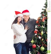 a pregnant woman and a man celebrating christmas royalty free