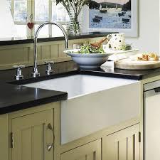 white farmhouse sink apron sink white cabinets dark counter tops