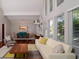 mid century modern living room with large glass wall design and