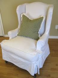 green chair slipcover white linen wingback slipcover with green pattern cushions and black