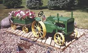 farm show 1 3 scale unstyled d deere tractor and wagon lawn ornament