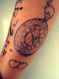 simple clock and small black hearts with tiny music symbol tattoo