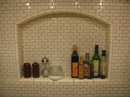 arched niche for range backsplash do in herringbone pattern