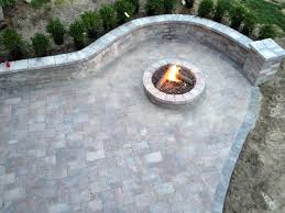 Unilock Patio Designs by Gas Fire Pit With Tumbled Unilock Brick Paver Wall And Pillar