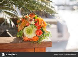 port orange florist wedding bouquet from white orange flowers roses lies a p