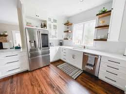 white kitchen cabinets wood floors white kitchen remodel from cherry to bright white