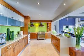bright farmhouse kitchen with green wall color and long wooden