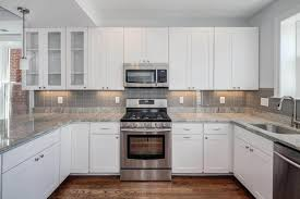 white groutless tile backsplash cabinet hardware room