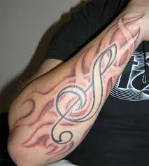 clef tribal fire tattoo