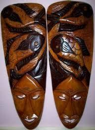 haitian carved wood sculpture of a haitian