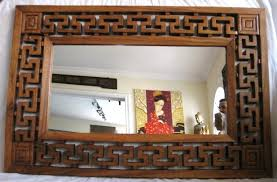 carved wood framed wall frames mirrors exotica furniture dubai decorative items