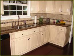 elegant kitchen backsplash white cabinets brown countertop white