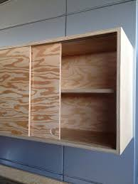 sliding cabinet doors diy sliding cabinet doors and discreet handles keep the piece looking