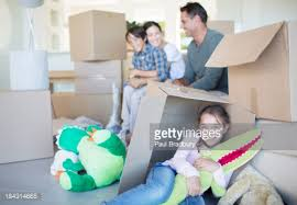 in livingroom boxes stacked in living room of house stock photo getty images