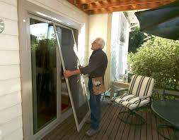 home decoration worker is working on replacement screen door in
