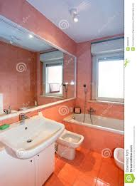 orange bathroom decorating ideas modern bathroom with white accessories and orange tiles orange