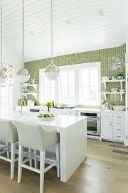 coastal living showhouse white and green kitchen features white