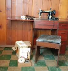Singer Sewing Machine Cabinets by Vintage Singer Sewing Machine Cabinet And Stool Ebth
