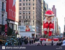 thanksgiving day on 2013 elf on the shelf cartoon character balloon floats past crowds