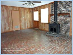interior brick flooring family room mediterranean with floor