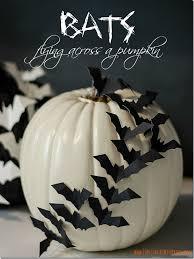 pumpkin black and white pumpkin bats flying across a pumpkin