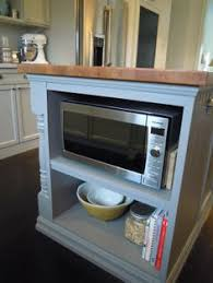 kitchen island microwave installing a microwave at the end of an island keeps it easy to