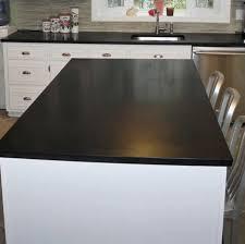 white kitchen cabinets and black quartz countertops solid black quartz countertop
