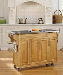 monarch kitchen island home styles monarch slide out leg kitchen island with granite top