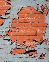 blue paint peeling off of a red brick wall stock photo 118062739