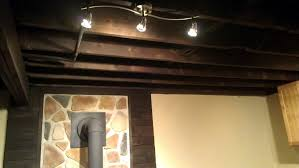 basement dark brown basement ceiling ideas with monorail track